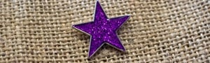 Purple star pin badge